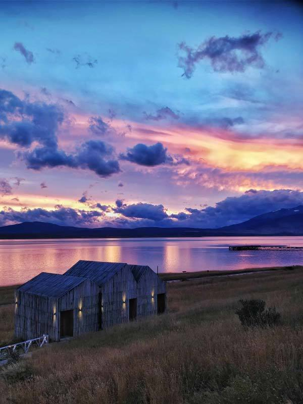 Views Seno Ultima Esperanza at sunset from the terrace of Simple Hotel Patagonia an unmissable stop on a one or two week Patagonia itinerary