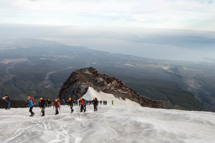 Hiking up the Villarrica Volcano in the snow, in Chile.