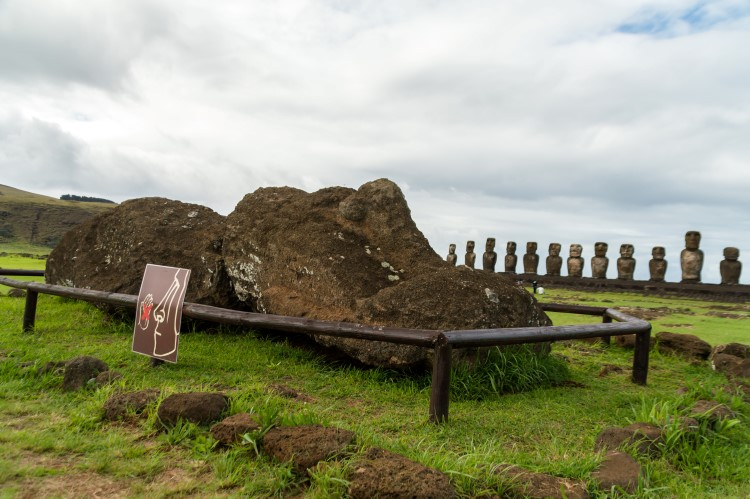 A fallen moai in front of the famous Ahu Tongariki on Easter Island, Chile
