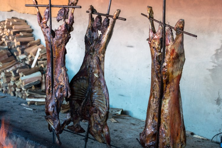 Lamb roasted over an open fire in Tierra del Fuego, Patagonia.