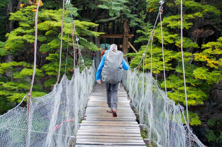 A drawbridge across the river leading to Campamento Italiano in Torres del Paine National Park, one of the free campgrounds you can reserve in the park