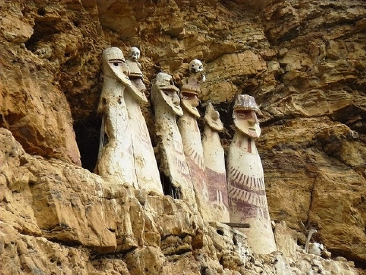 The Sarcophagi of Karajia on a ledge in the cloud forest near Chachapoyas Peru