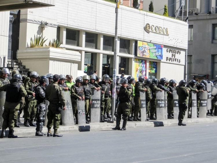A protest in La Paz Bolivia. Stay safe in Bolivia by avoiding all protests or street demonstrations