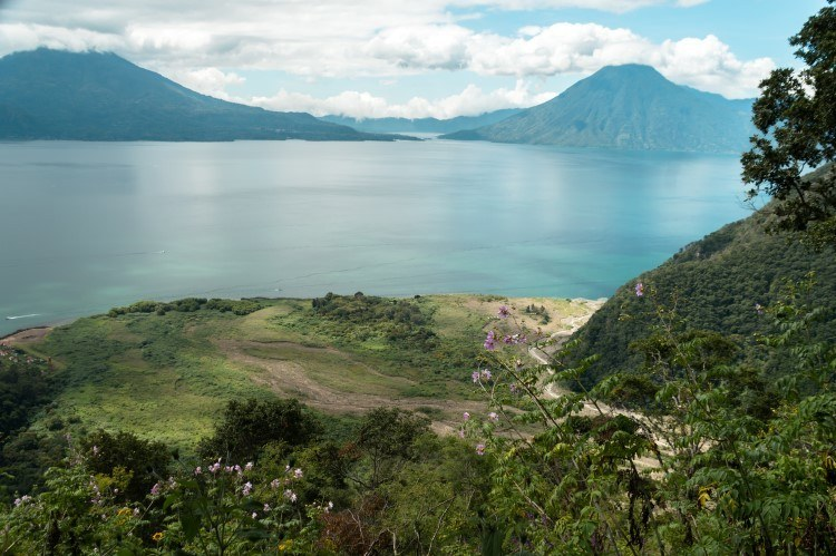 The crystalline waters of Lake Atitlan, top of what to do in Guatemala and bursting with sustainable tourism initiatives