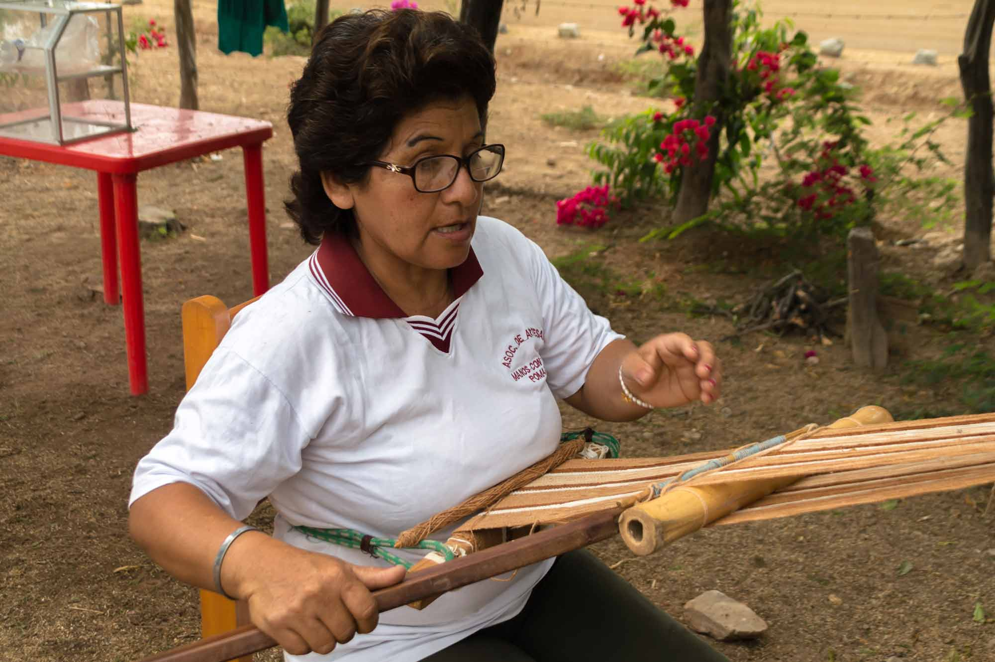A weaver makes textiles using organic, wild cotton in the Bosque de Pomac in northern Peru, a responsible tourism destination in South America