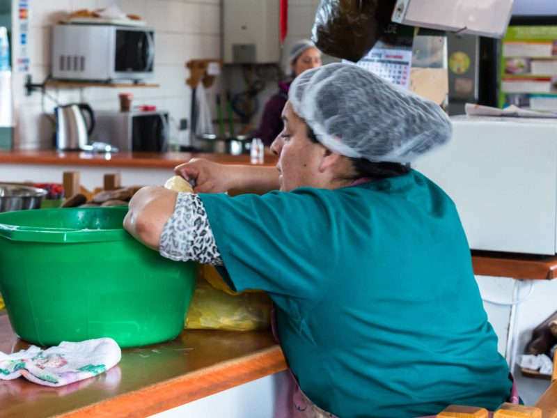 A woman prepares food in the Dalcahue market in Chile