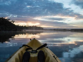 A kayak in the Rio Chepu at dawn in Chiloe, Chile and an unmissable Chile travel destination