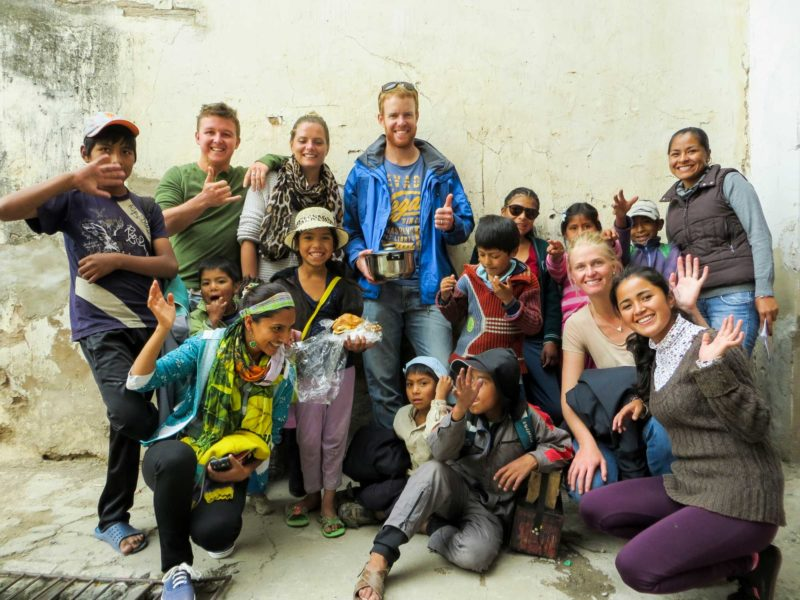A group of volunteers and children in South America
