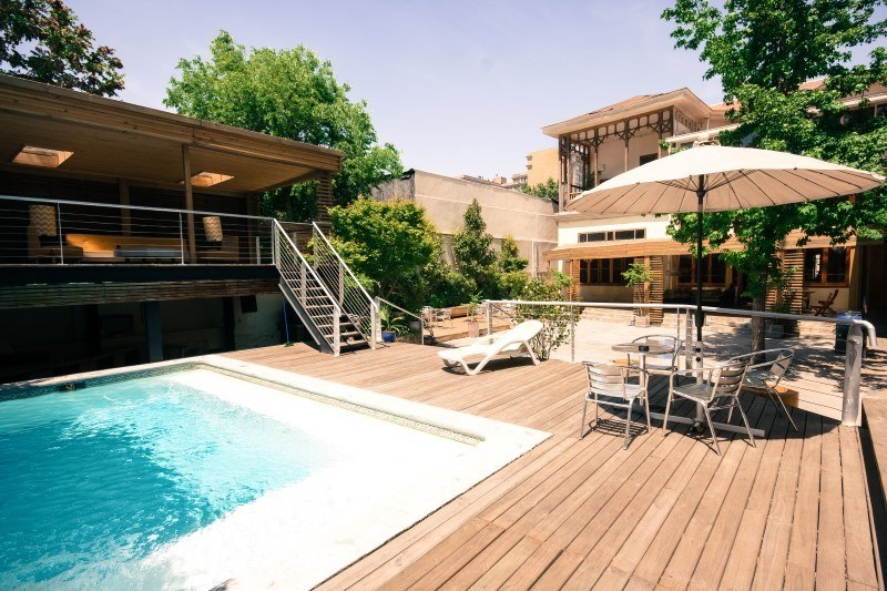 Where to stay in Santiago, Chile: Happy House Hostel has a sun-splashed terrace and pool