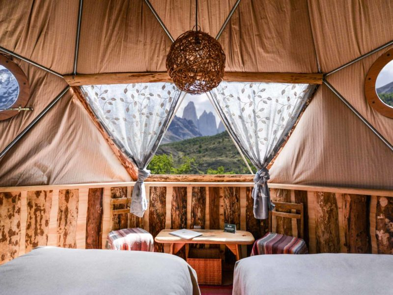 Views of the towers from the bed of one of the EcoCamp Patagonia glamping domes, one of the top Torres del Paine hotels in Chilean Patagonia