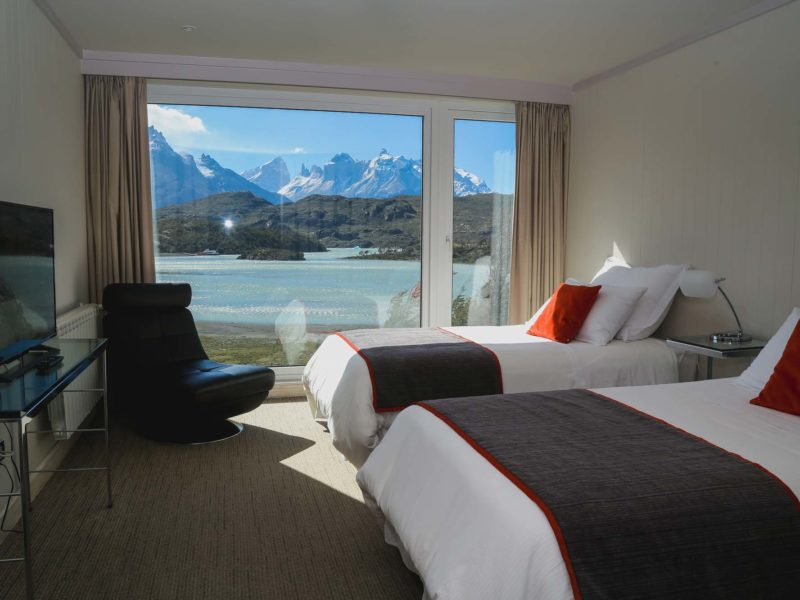 Views from the bedroom across Lago Grey and the Cuernos del Paine from Hotel Lago Grey, one of the top Torres del Paine hotels in Chilean Patagonia