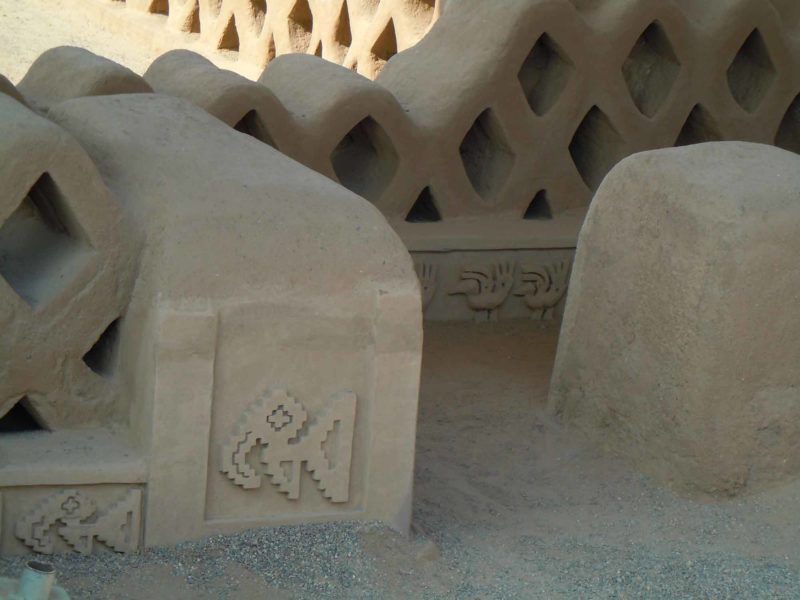 Relief carvings in the adobe on the walls of the ancient city of Chan Chan near Huanchaco and Trujillo, Peru