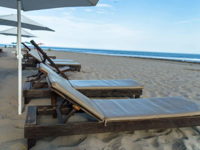 Sun loungers on the main beach in Mancora one of the most popular places to visit in Peru for backpackers and surfers