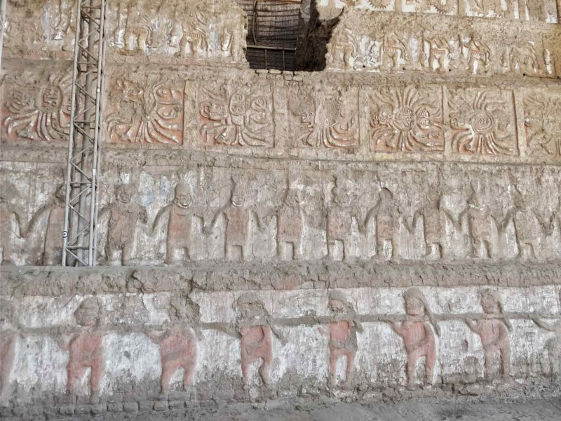 The frieze murals on the side of the Huaca de la Luna near Trujillo and a top destination for those with an interest in history and archeology in Peru