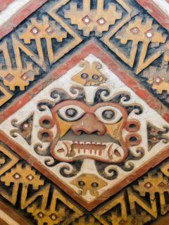 An ancient, polychrome frieze in Huaca de la Luna near Trujillo Peru