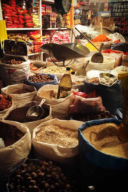Bags of dried goods in a La Paz market, one of the things to do in La Paz Bolivia