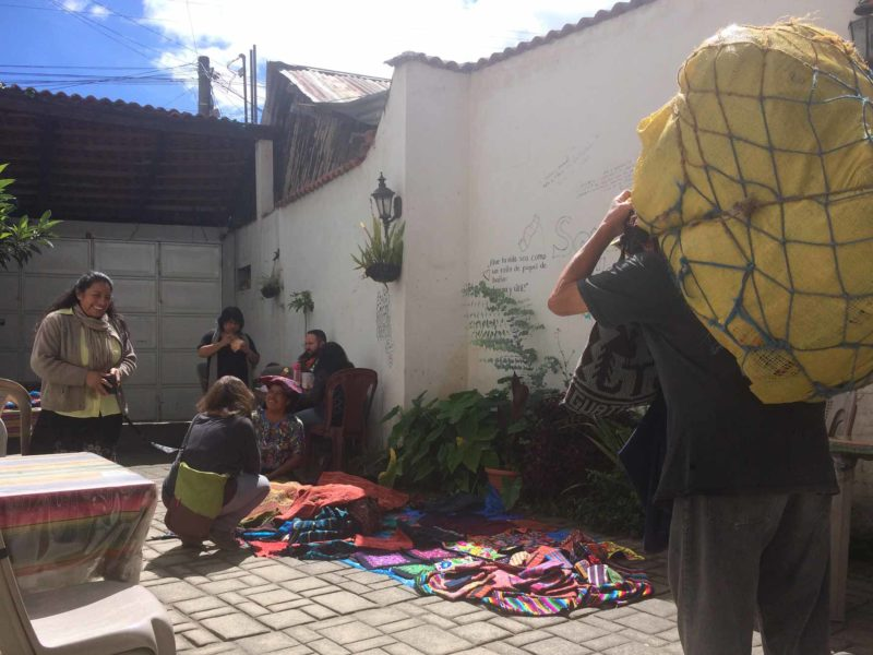Visitors selling their wares outside an English language school yard in Guatemala