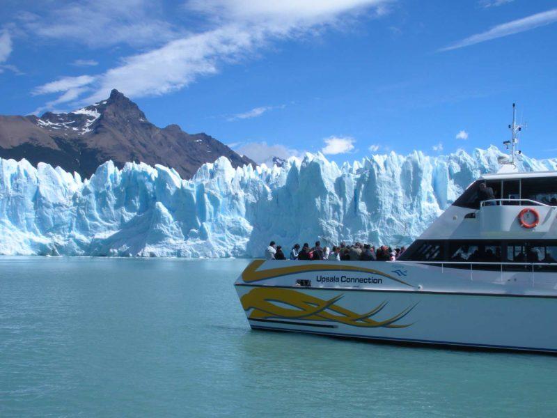 A boat approaches the snout of the Perito Moreno Glacier in Parque Nacional Los Glaciares near El Calafate Argentina