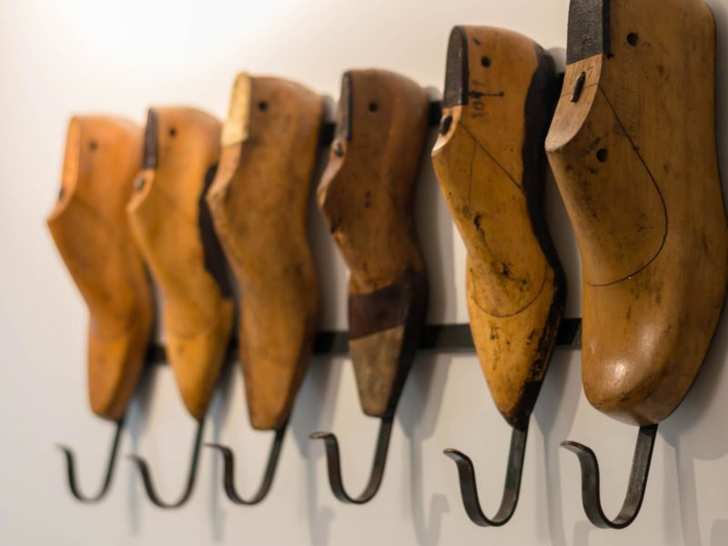 Wooden shoe moulds act as a coat hanger on the walls of the bedrooms in Selina, a great place to stay in Lima, Peru