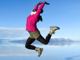 Picture of Steph Dyson, aka Worldly Adventurer, jumping into the sky at the Salar de Uyuni in Bolivia