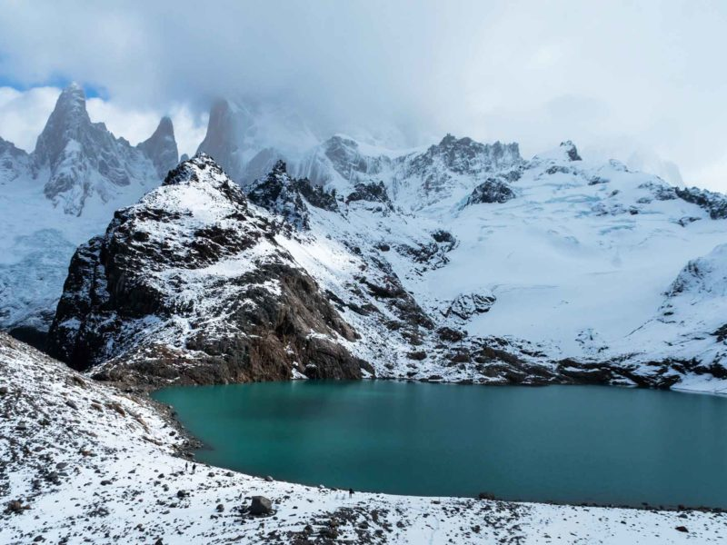 Mountains overlook a brilliant turquoise lake in El Chalten Argentina on this South America Backpacking Route.
