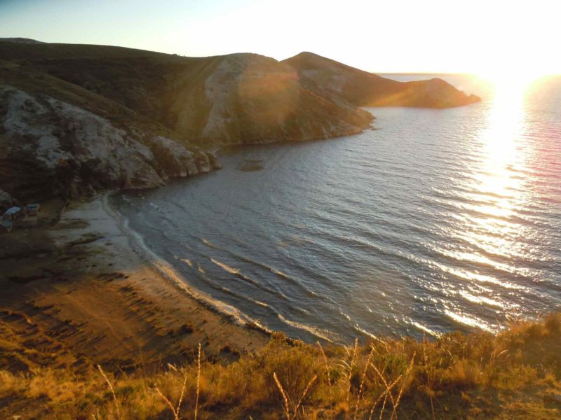 The Sunset over Mountains and Beaches on the Isla del Sol on this South America Backpacking Route.