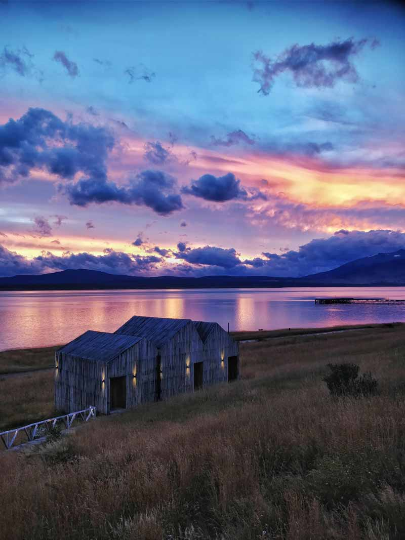 Sunset over Simple Patagonia, a hotel in Puerto Natales and a must on any South America backpacking route