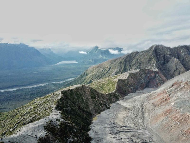 Sharp mountains overlook the wilderness and glaciers of Pumalin National Park along these South America Backpacking Routes