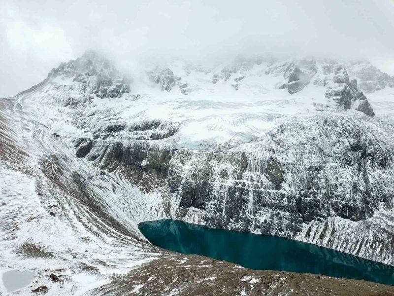 Lago Cerro Castillo and the Cerro Castillo range shrouded in mist in Cerro Castillo National Park, along Chile's Carretera Austral