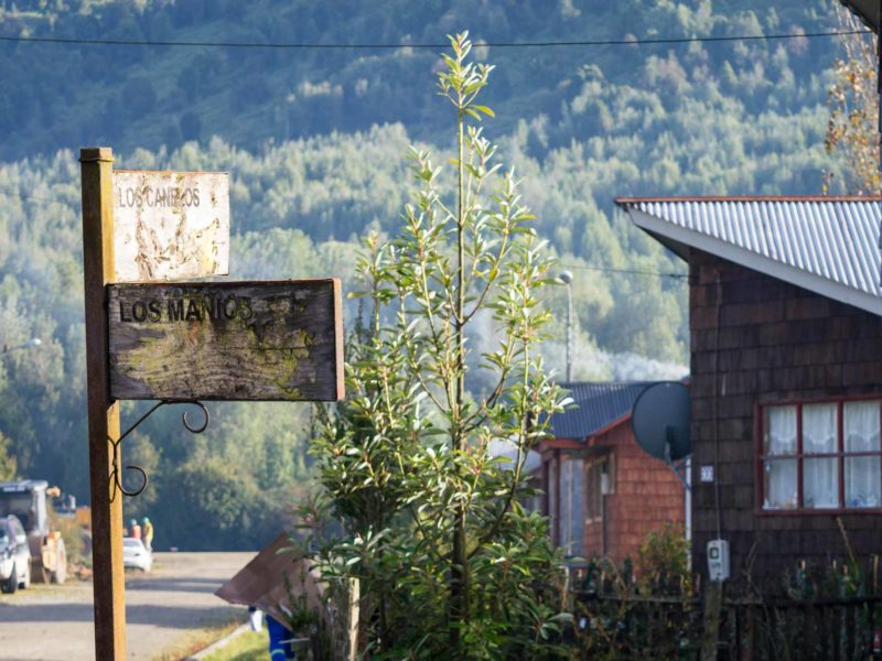 Wooden houses and a wooden road side in Puyuhuapi, along Patagonia's Carretera Austral