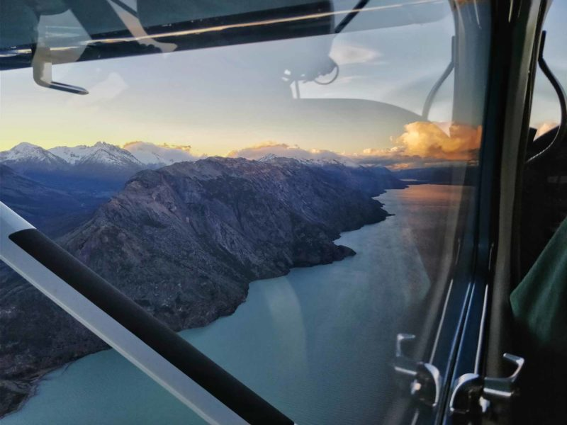 Inside of a light aircraft with views out of the window at the mountains surrounding Villa O'Higgins along the Carretera Austral