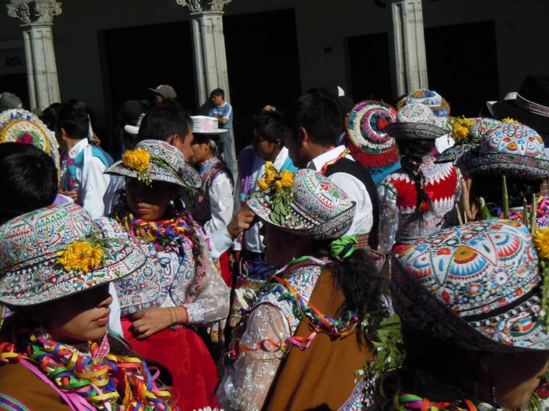 The brightly decorated hats of Arequipa Traditional Dress on this South America Backpacking Route