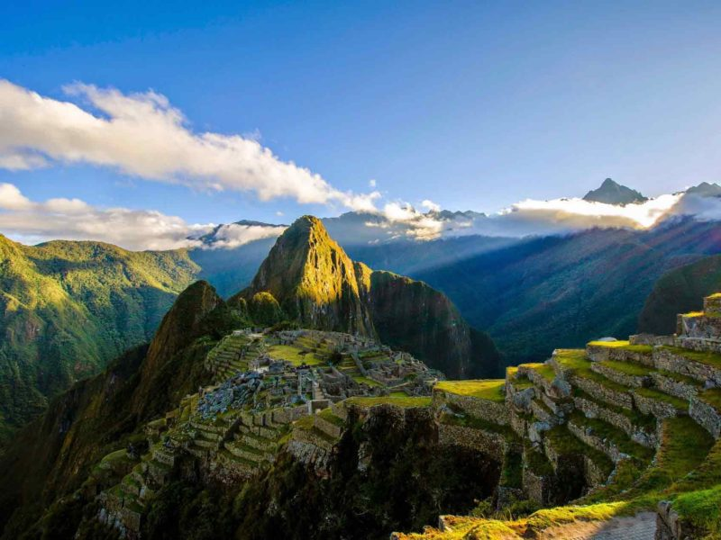 A view of Machu Picchu at dawn from above the ruins