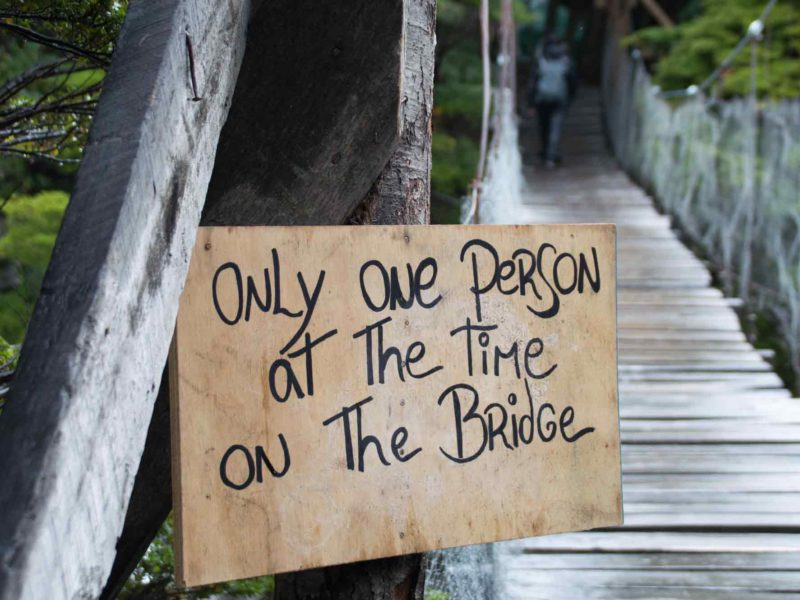 A sign on a bridge in Torres del Paine National Park