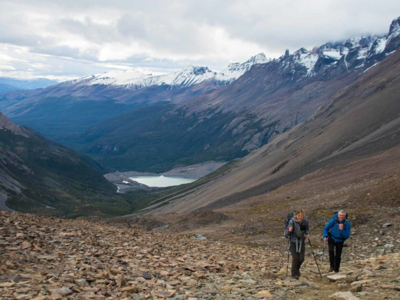 Hikers climbing the screen path up to Paso John Gardner while trekking the O Circuit in Torres del Paine National Park, Patagonia