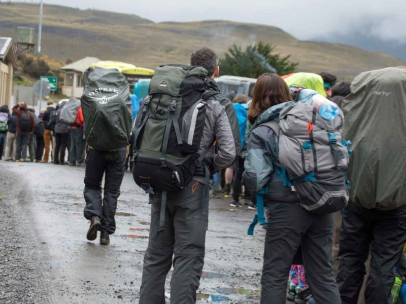 Queuing hikers at the Laguna Amarga entrance and trailhead for hiking the O Circuit in Torres del Paine National Park, Patagonia