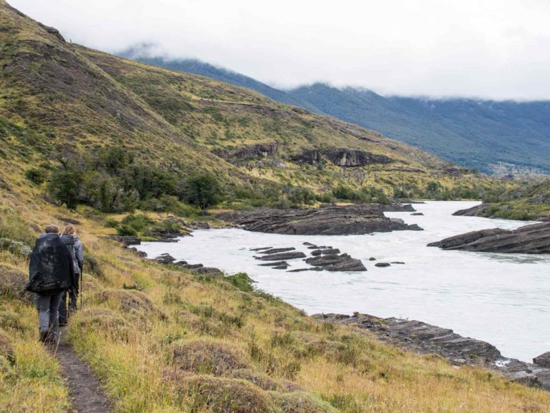 A hiker takes the trail alongside Rio Paine while hiking the O Circuit in Torres del Paine National Park, Patagonia