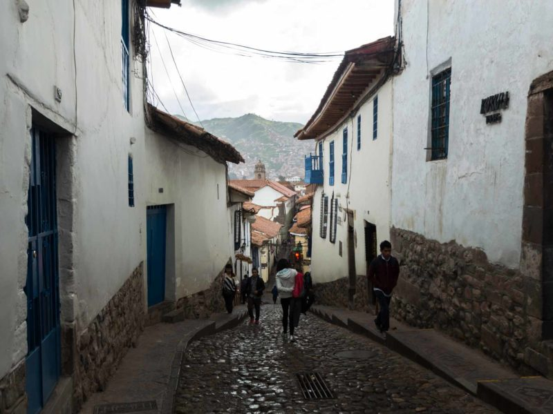 The cobbled streets of Santa Ana, one of the main neighbourhoods where to stay in Cusco, Peru