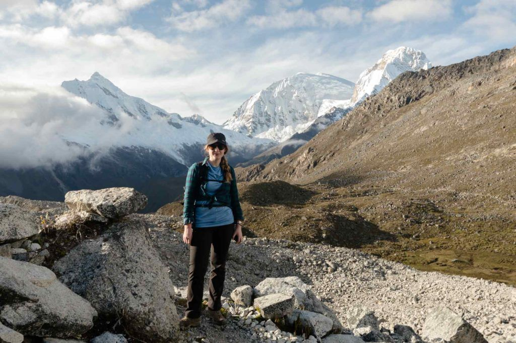 Steph Dyson, Peru trip planner, standing in front of snowy mountains in Huaraz