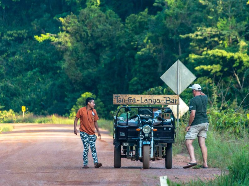 Two men chat at a popular tourist attraction - a mobile roadside bar on the only highway in Guyana.