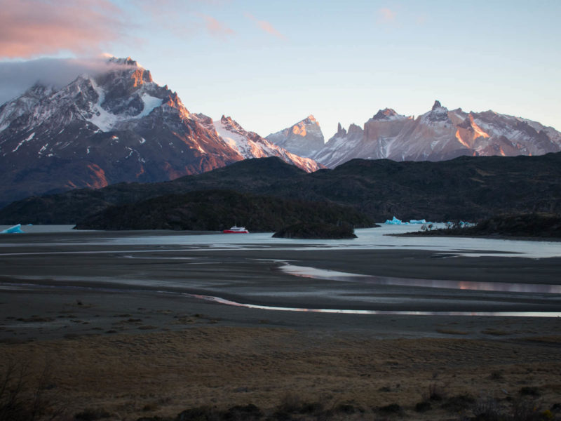 Icebergs float in the quiet waters at sunset on Lago Grey, seen from a viewpoint in Torres del Paine National Park, Patagonia