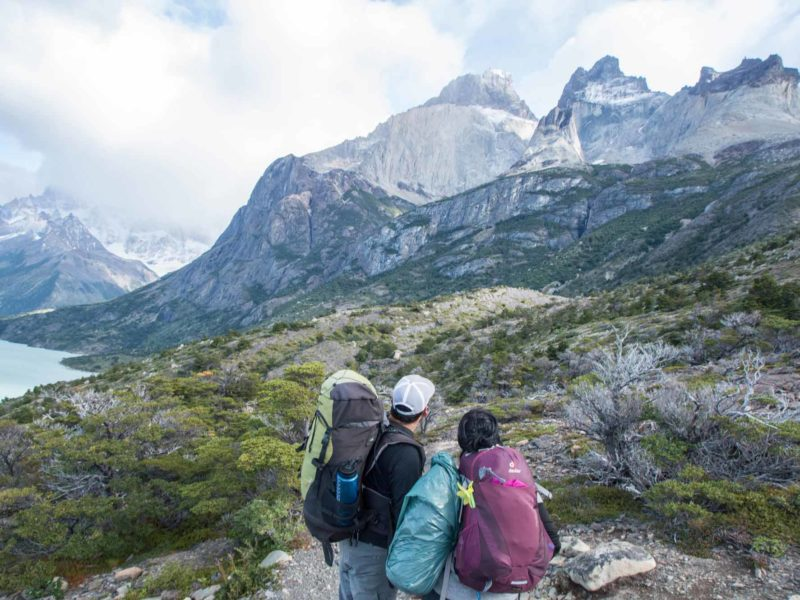 Two hikers with day packs on the trails in Torres del Paine National Park, Patagonia
