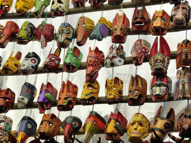 Wooden masks on display at a Guatemalan market