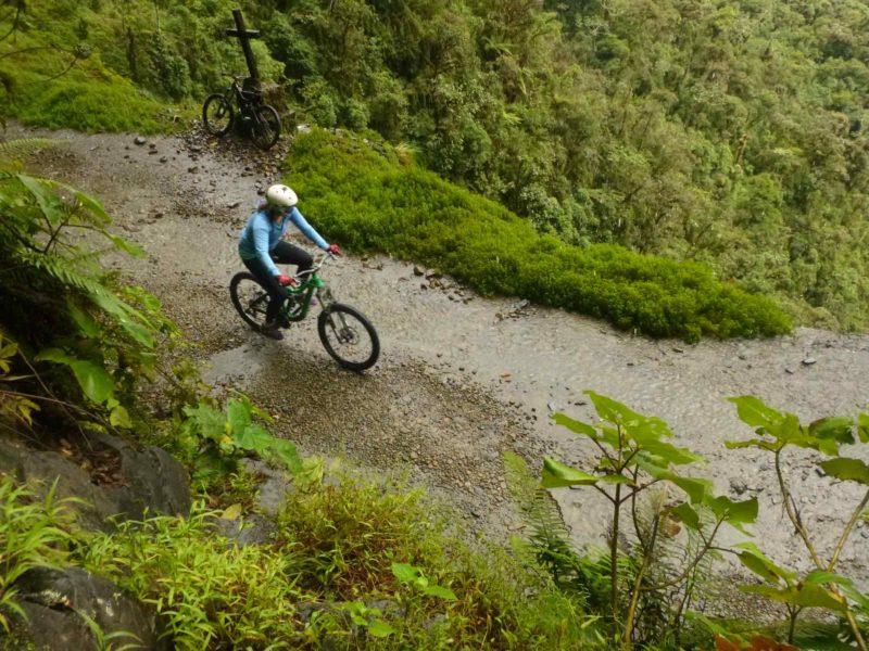 A mountain biker riding down Death Road in Bolivia