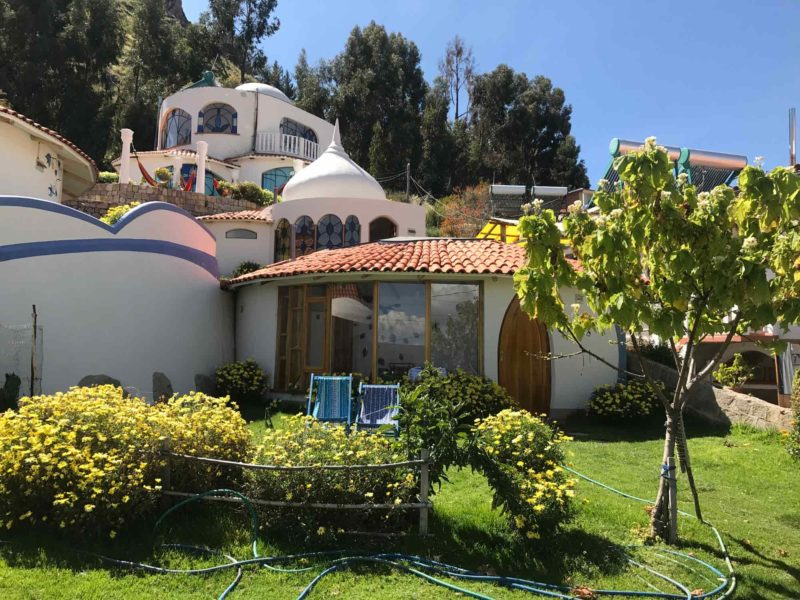The outside of the picturesque Hotel La Cupula on Isla del Sol, a must-visit on a Bolivian itinerary